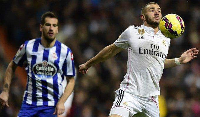 Alberto Lopo of RC Deportivo La Coruña in action with Karim Benzema (R) of Real Madrid CF during their Spanish Liga match.jpg